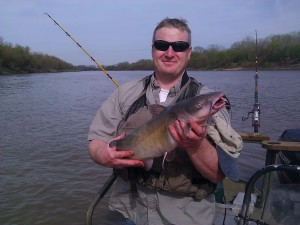 Alex and a 12# Kaw river channel dog